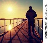 Man Silhouette Walk On Wharf...