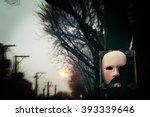 Phantom of the Opera Mask with Dramatic Trees - stock photo