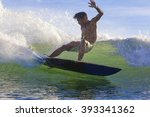 surfing a wave  bali  indonesia  | Shutterstock . vector #393341362