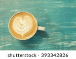 coffee cup on a wooden table ... | Shutterstock . vector #393342826