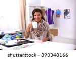 smiling female fashion designer ... | Shutterstock . vector #393348166