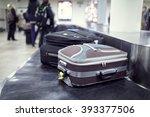 suitcase on luggage conveyor... | Shutterstock . vector #393377506
