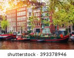 Stock photo amsterdam canal at sunset amsterdam is the capital and most populous city in netherlands 393378946