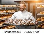 handsome baker in uniform...   Shutterstock . vector #393397735