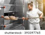 handsome baker in uniform... | Shutterstock . vector #393397765