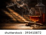Glass of whiskey with smoking...