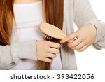 Teen Woman Brushing Her Hair.