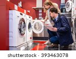 young couple choosing washing... | Shutterstock . vector #393463078