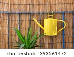 Yellow Metal Watering Can Hang...