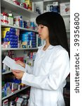 pharmacist searching the right medicine - stock photo