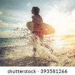 woman running into the sea with ... | Shutterstock . vector #393581266