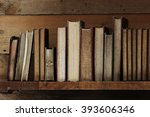 old books on wooden shelf. | Shutterstock . vector #393606346