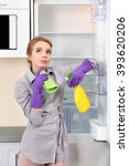 young woman cleaning empty... | Shutterstock . vector #393620206