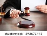 judge hitting gavel with paper... | Shutterstock . vector #393671446