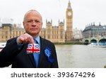 conservative politician holding ... | Shutterstock . vector #393674296