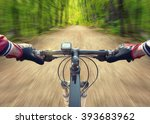 Ride on bicycle on road in summer forest. Sport and active life concept - stock photo