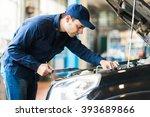 mechanic at work in his... | Shutterstock . vector #393689866