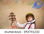 kid astronaut with cardboard...   Shutterstock . vector #393741232