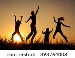 happy family jumping near the... | Shutterstock . vector #393764008