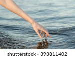 the human hand touches the... | Shutterstock . vector #393811402