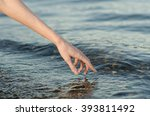 the human hand touches the... | Shutterstock . vector #393811492
