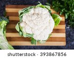Cauliflower On The Wooden Board