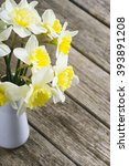 white daffodils at china vase... | Shutterstock . vector #393891208