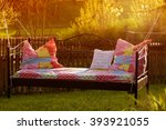bed in the garden at sunset  ... | Shutterstock . vector #393921055
