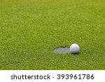 Golf Ball At The Edge Of...