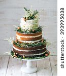 rustic wedding cake | Shutterstock . vector #393995038