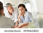 business people meeting around... | Shutterstock . vector #394062802