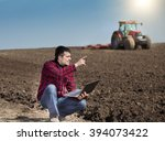 young farmer with laptop...   Shutterstock . vector #394073422