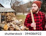 serious lumberjack holding axe...   Shutterstock . vector #394086922