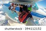 parachutists hanging off the... | Shutterstock . vector #394112152