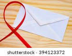 close up of a red ribbon with... | Shutterstock . vector #394123372