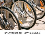 row of parked vintage bicycles... | Shutterstock . vector #394136668