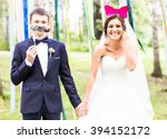 Stock photo april fools day wedding couple posing with mask 394152172