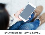 woman use of mobile phone | Shutterstock . vector #394152952