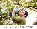 father holding little son ... | Shutterstock . vector #394182586