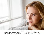 Woman Sitting On Window Sill ...