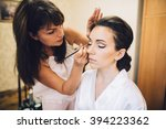 wedding makeup artist making a... | Shutterstock . vector #394223362