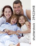 portrait of young family lying...   Shutterstock . vector #39423448