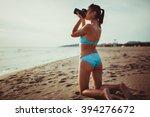 happy woman photographer on... | Shutterstock . vector #394276672