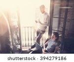 young couple work together.... | Shutterstock . vector #394279186