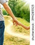 a the parent holds the hand of... | Shutterstock . vector #394285525