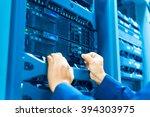 man fix server network in data... | Shutterstock . vector #394303975