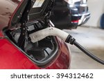 electric car charging in a... | Shutterstock . vector #394312462