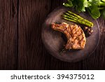 grilled pork chops and... | Shutterstock . vector #394375012
