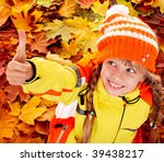 Girl in autumn orange hat with thumb up.  Outdoor. - stock photo