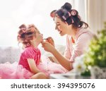 happy loving family. mother and ... | Shutterstock . vector #394395076